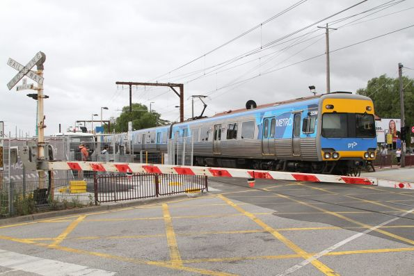 Comeng 325M leads an up service out of Clayton station