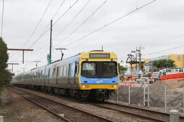 Comeng train on a down Pakenham service passes level crossing removal works at the down end of Clayton