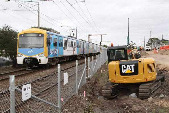 Citybound Siemens train passes level crossing removal works at the down end of Clayton