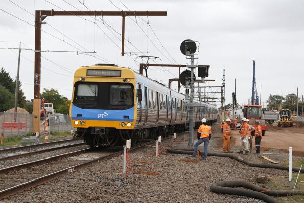 Comeng train on a down Cranbourne service traverses the track slew at the Centre Road level crossing at Clayton