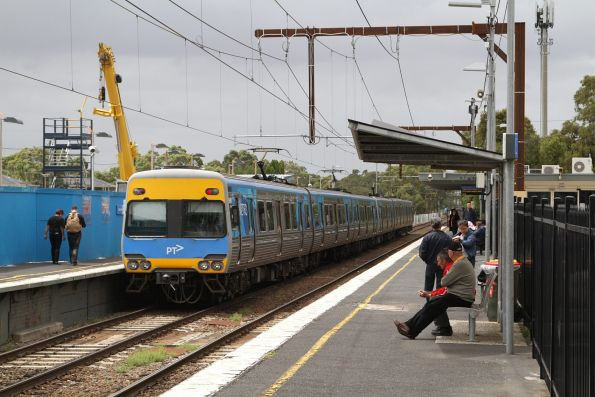 Comeng train departs Noble Park station on a down service