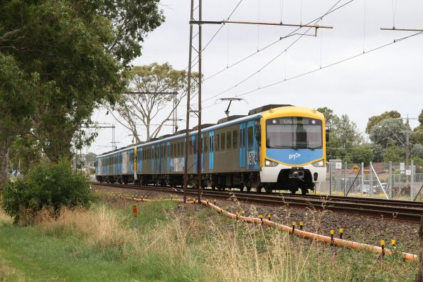 Siemens train approaches Noble Park on an up service