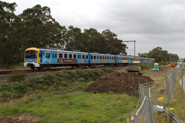 Siemens 750M trails a down Pakenham service crossing the Mile Creek bridge at Noble Park