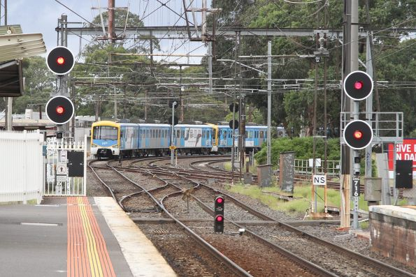 Siemens train departs Dandenong station on the down