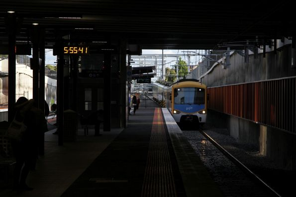 Siemens train arrives into Ormond station on the up