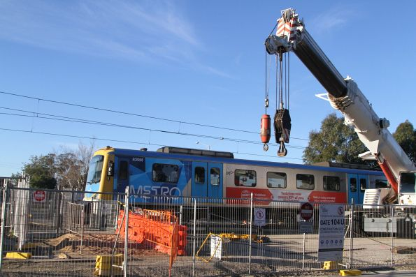 Siemens 839M on a citybound service passes a crane near Cosy Gum Road in Carnegie