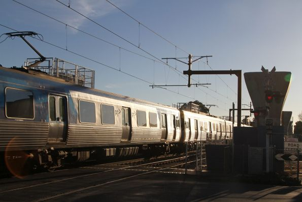 Citybound Comeng train passes through the Murrumbeena Road level crossing