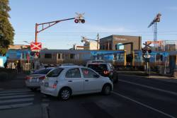 Citybound Comeng trains 385M and 496M pass through the Murrumbeena Road level crossing