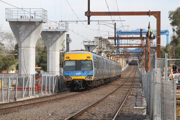 Alstom Comeng trails an up train out of Hughesdale