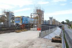 Siemens train passes completed Skyrail piers at Murrumbeena