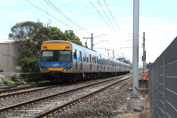 Alstom Comeng trails an up Pakenham service over the Progress Street level crossing at Dandenong South