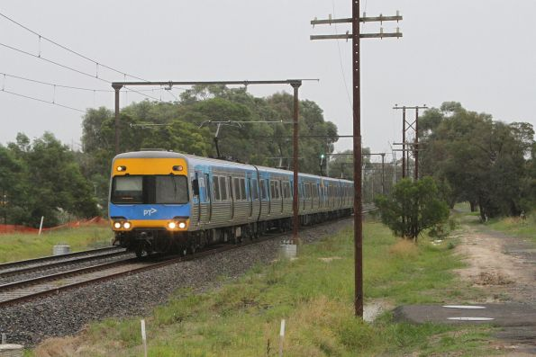 Alstom Comeng train approaches Brunt Road in Beaconsfield