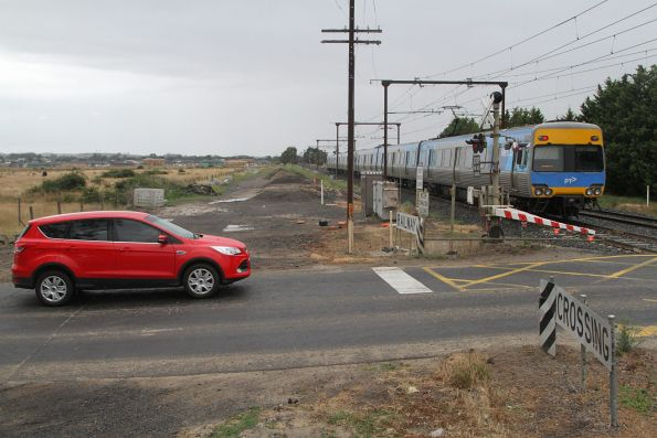 Alstom Comeng train crosses the Brunt Road level crossing in Beaconsfield