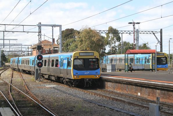 Comeng 382M arrives into Caulfield with an up Dandenong service