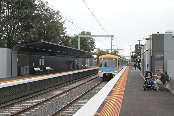 Siemens train arrives into Southland station on the down