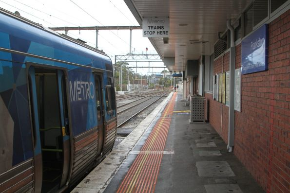 Comeng train stands at the 'Metro Trains stop here' notice at Frankston platform 2