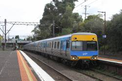 Comeng 419M passes through Toorak station on a down service