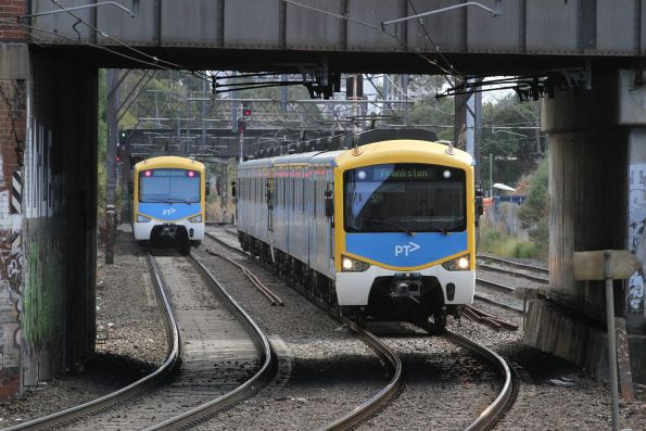 Siemens trains on up and down Frankston services cross paths outside Malvern station