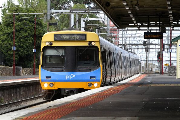 EDI Comeng train on an up Dandenong group service passes through Malvern station