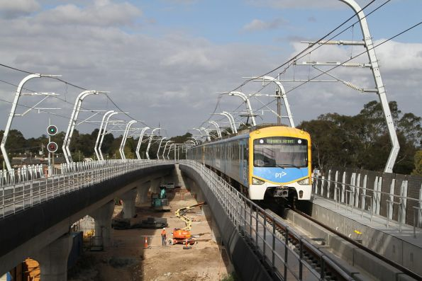 Citybound Siemens train approaches the new elevated station at Noble Park