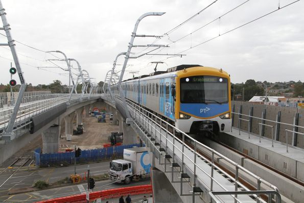 Siemens train arrives into the new elevated Clayton station with a down Cranbourne service