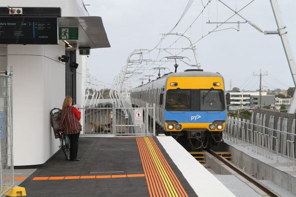 Alstom Comeng train arrives into the new elevated Clayton station with an up service