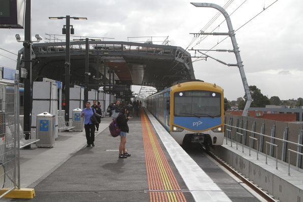 Siemens train arrives into the new elevated Clayton station with a down Pakenham service