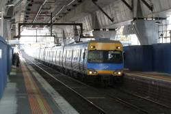 Alstom Comeng train arrives at Murrumbeena station on the up
