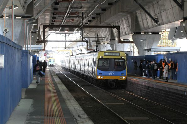 EDI Comeng train arrives into Murrumbeena station with an up service
