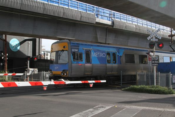 Alstom Comeng 323M crosses Murrumbeena Road on a down service