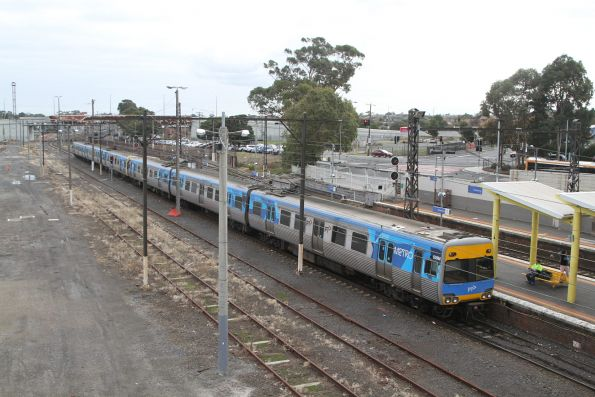 Alstom Comeng 639M trails an up Cranbourne service out of Dandenong station