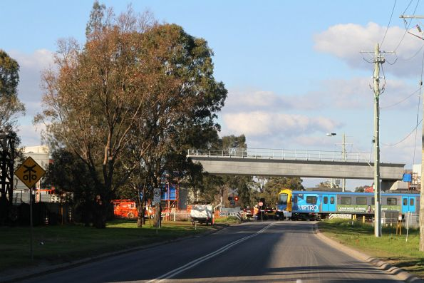 Siemens 767M passes under the incomplete Abbotts Road grade separation in Dandenong South