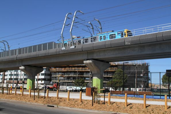 Citybound Siemens train runs along the 'Skyrail' viaduct at Clayton