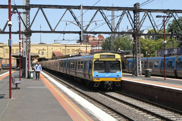 EDI Comeng train arrives into South Yarra on an up Frankston service