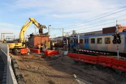 Siemens train runs express through Carrum, as the building on platform 2 is demolished