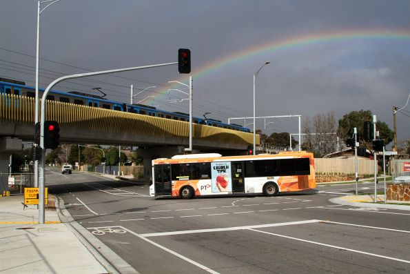 Ventura bus #668 on route 790 passes under a Siemens train on the Seaford Road bridge