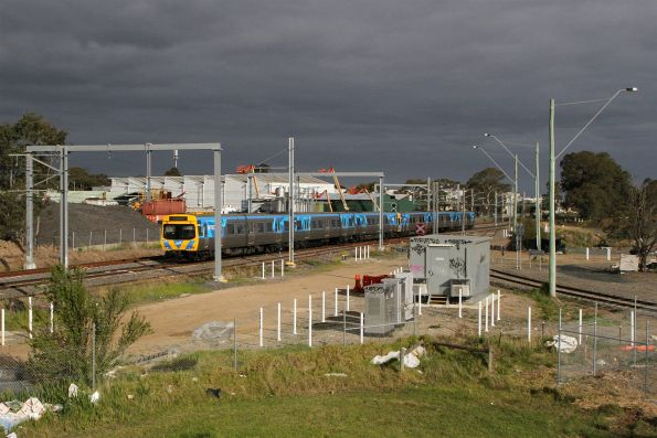 Life extension EDI Comeng 508M passes the Kimberley Clark Siding at Dandenong South
