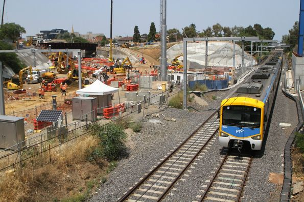 Siemens 753M on an up Sandringham service passes Metro Tunnel works at South Yarra