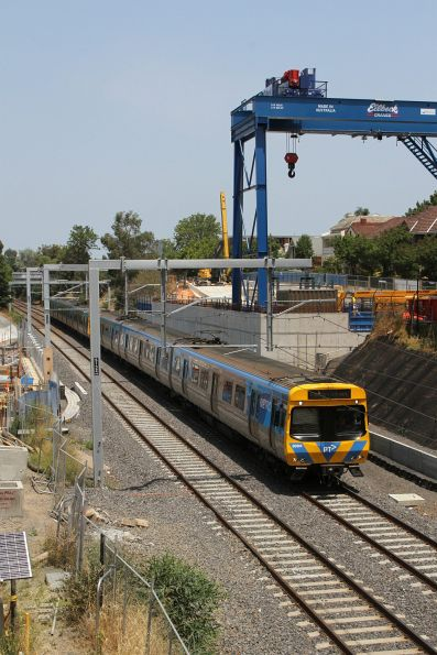 Life extension EDI Comeng 369M on an up Sandringham service passes Metro Tunnel works at South Yarra