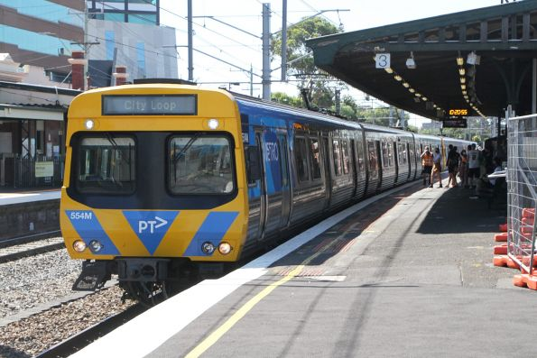 EDI Comeng 554M terminates at Caulfield platform 3 with an up service from Dandenong