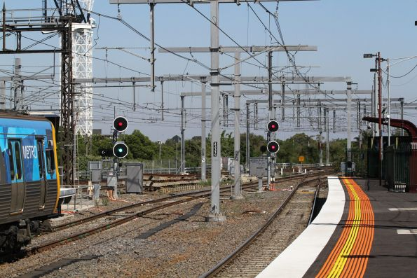 Signal CFD727 at Caulfield platform 3 cleared for an up train to cross over onto the up Caulfield Through track