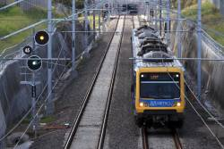 X'Trapolis on an up service departs South Morang
