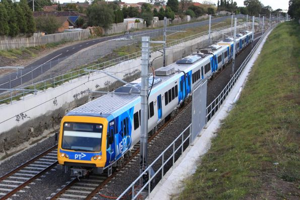X'Trapolis 151M in PTV livery passes under Pindari Avenue on the South Morang extension