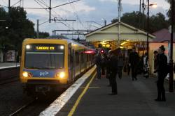 X'Trapolis train arrives into Clifton Hill on a Flinders Street bound service