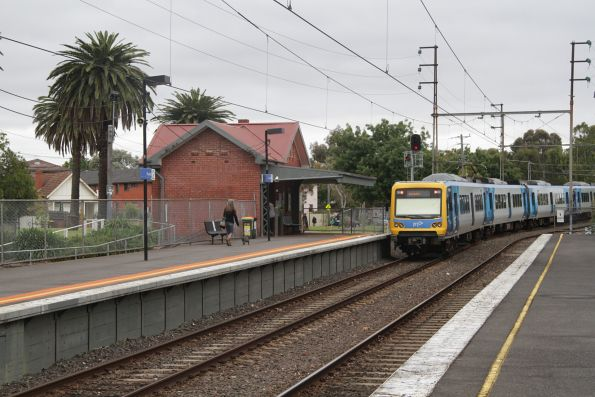 X'Trapolis train departs Rushall on a down South Morang service