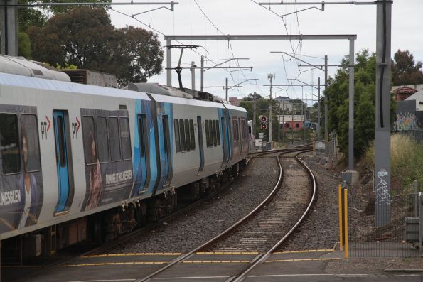 X'Trapolis train departs Westgarth on an up service
