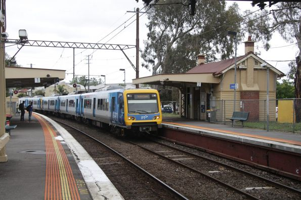 X'Trapolis 874M leads a down service into Westgarth
