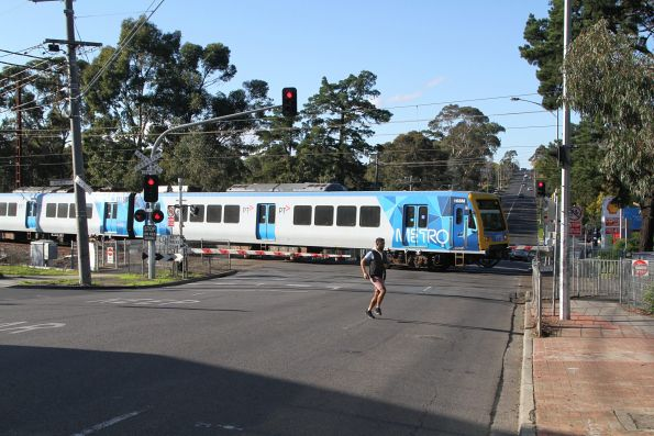 X'Trapolis 168M crosses the Lower Plenty Road level crossing on arrival at Rosanna station
