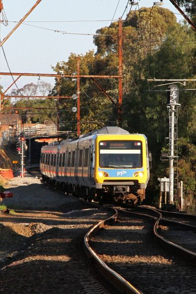 X'Trapolis 135M on a down Hurstbridge service departs the single track section at Heidelberg
