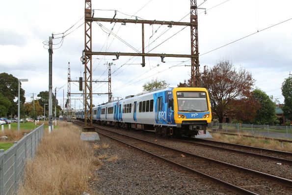 X'Trapolis 951M leads a down service towards Bell station